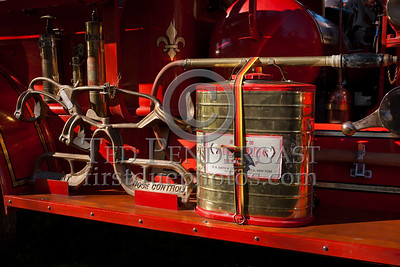 Indian Can and Elkhart Hose Control Appliance on Antique Fire Truck running board