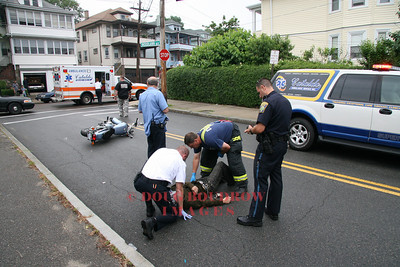 Everett, MA - Fire and EMS personnel treat a patient that was injured after losing control of his motorcycle, 6-23-08.