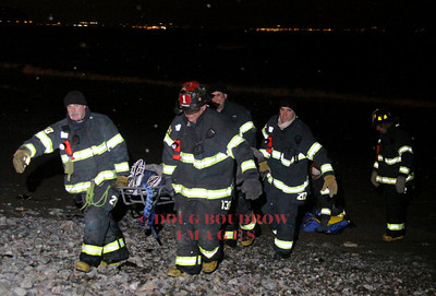 Winthrop, MA - Fire and EMS crews carry a victim off the beach in freezing cold weather to attempt in an revive him after an apparent suicide attempt, 1-20-09.