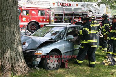Winthrop, MA - Firefighters extricate victims from a wrecked car in a mock accident drill to demonstrate the dangers of drunk driving to a youth group, 7-8-08