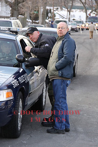 Winthrop, MA - State and local police discuss strategies at 190 River Road. A suspect in an armed robbery case was believed to be in the house. However he later turned himself in at the Winthrop Police station, 1-26-09.