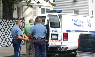 Chelsea, MA - A suspect is arrested after being chased by local and state police for an armed robbery at a local bank, 8-21-06.