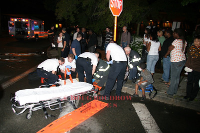 Malden, MA - Fire and EMS crews treat several patients that were injured in a head-on car collision, 5-31-08.