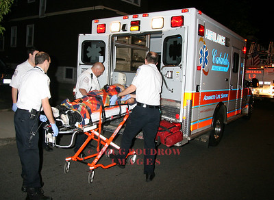 Everett, MA - Cataldo paramedics transport a patient that was injured when his car crashed into the front of a house. 8-23-08.