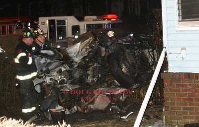 Chelsea, MA - A person was fatally injured after their car crashed into a house and burst into flames on Revere Beach Parkway at Union Street, 2-12-07.