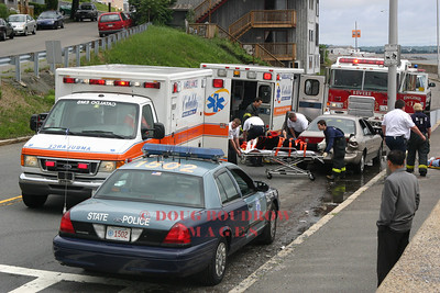 Revere, MA - A patient is transported to the hospital by Cataldo EMS Paramedics after a two car MVA on Winthrop Parkway, 7-9-05.