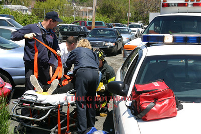 Winthrop, MA - A patient is treated by Fire and EMS crews after her car was struck head on by a transit bus on Veterans Road, 6-2-05.
