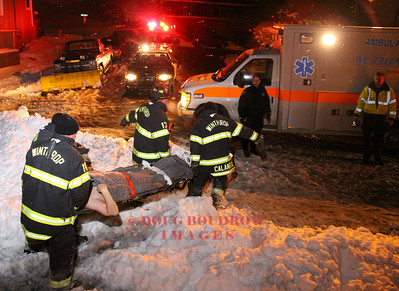 Winthrop, MA - Fire and EMS crews carry a victim off the beach in freezing cold weather in an attempt to revive him after an apparent suicide attempt, 1-20-09.