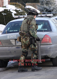 Winthrop, MA - A trooper from the Mass State Police STOP team prepares his gear at 190 River Road. A suspect in an armed robbery case was believed to be in the house. However he later turned himself in at the Winthrop Police station, 1-26-09.
