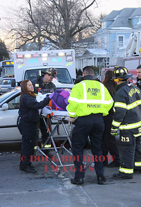 Winthrop, MA - Fire and EMS crews remove a patient from a car at an accident at the intersection of Pauline and Plesant Streets.