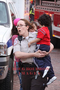 Boston, MA - An EMT from Boston EMS carries a child that was removed from an MBTA green line trolley after it collied with another train, 5-8-09.