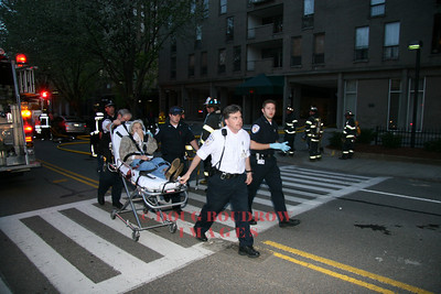 Brookline, MA - A smoke inhilation victim is transported from the scene of an apartment fire at 99 Pond Street by crews from Fallon EMS, 5-4-07.