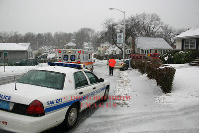 Winthrop, MA - Fire, Police, and EMS crews on scene of one of many accidents caused by a snowstorm, 1-8-05