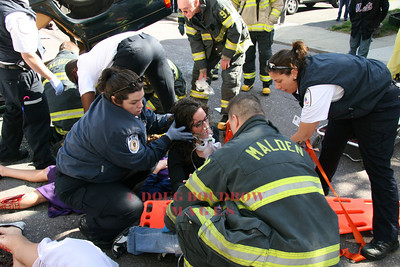 Malden, MA - Fire and EMS crews extricate and treat several patients in a mock car accident to demonstrate the dangers of drunk driving to Malden High School students, 5-14-08.
