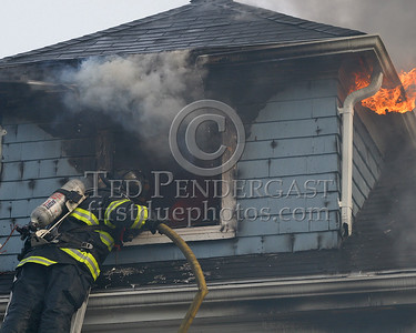 Peek-a-boo -Somerville Engine Co operating a line in the dormer