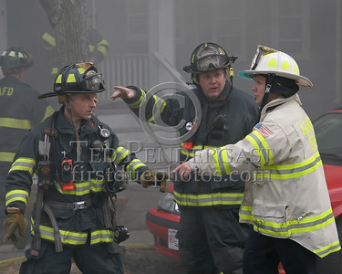 A Medford crew gets orders from an Arlington Deputy Chief