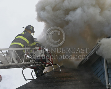 Ladder 1 opening the roof with a saw