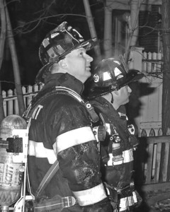 Members of Engine Co.1 standing fast