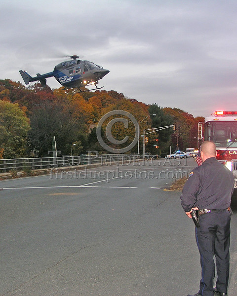 Belmont PD Ofc Brendan Young secures the LZ as MedFlight-3 approaches landing assured