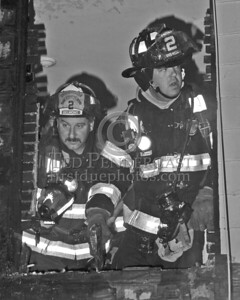 Members of Engine Co.2 after opening the walls in the first floor kitchen area