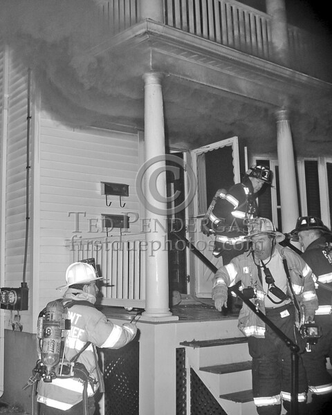Members Reenter The Building After A Bottle Change. Capt.McCabe And Asst.Chief Davison Discuss Orders For The Incoming 3rd Alarm Companies