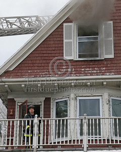 A member of Engine 16 on the 2nd floor porch
