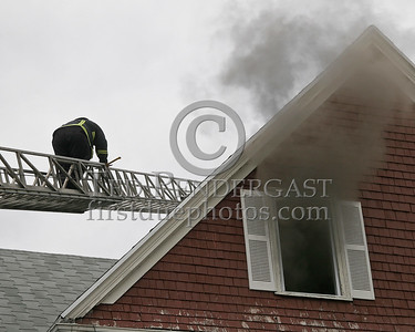 A member of Ladder 29 headed to the roof to assist Ladder 6 with opening up
