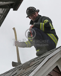 A member of Ladder 23 on the roof - work complete