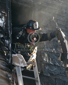 A Lt. from Squad 4 overhauling on the third floor