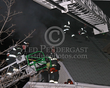 Ladder 4 completed horizontal ventilation as Ladder 1 prepares to open the roof