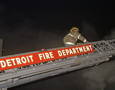 Detroit,MI - Working Fire 4750-4754 Seyburn St. - Arson fire in 1.5-sty woodframe occupied dwelling. 20:30hrs. -- FF on Ladder 10's stick