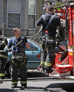"""""""Packing Up"""" - FDNY Engine Co 46 & 48 repacking hose on Engine 48 - 2nd Alarm in the Bronx on Bristow St."""