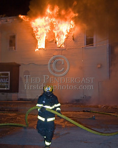 Repositioning A Big Line On Springfield St -- 5+Alarms transmitted for a major fire that destroyed or damaged nearly a dozen buildings in South Lawrence in the frigid early morning hours of Mon.,Jan.21,2008.
