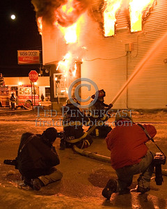 Andover Firefighters With A Big Line On Springfield St Being Photographed By Photographers Rick Nohl And Jim Daly Jr. -- 5+Alarms transmitted for a major fire that destroyed or damaged nearly a dozen buildings in South Lawrence in the frigid early morning hours of Mon.,Jan.21,2008.