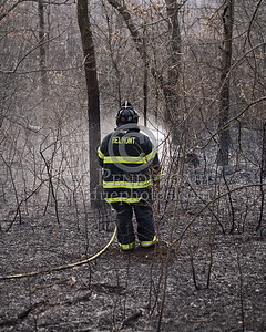 Lexington MA - Belmont Firefighters Operating at Major Brush Fire in The Great Meadows off Circle Rd.  Friday, April 17, 2009 Lt Andrew Tobio