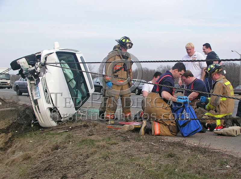 MVA Rte.91 Southbound in North Haven,CT. North Haven FD arrives and goes to work on the patient...