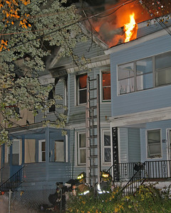Raising A Ground Ladder To The Delta Exposure (216 Oakwood Pl)
