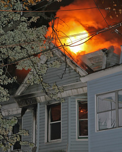 Fire Through The Roof Of The Building Of Origin