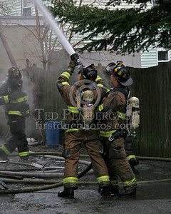 Firefighters Operating An Exterior Line At The Rear Of The Building
