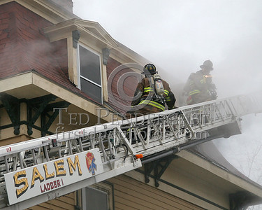 Salem Firefighters On Ladder 1's Stick Venting Third Floor Windows On The Delta Side