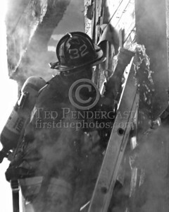 Boston Firefighter from Engine 32 on ground ladder