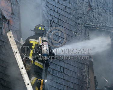 Boston Engine 32 playing a line into the third floor