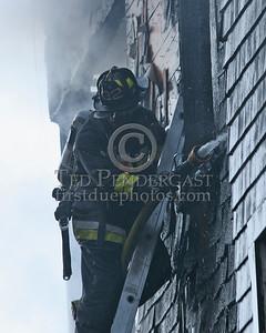 Boston Firefighter from Engine 32 on ground ladder
