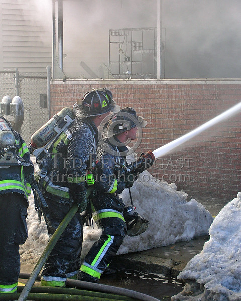 Boston Engine Co.3's Crew Playing A Line Through The Storefront