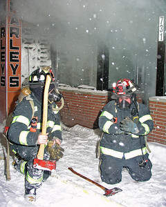 Members of Newton Ladder Co.3 preparing to make entry