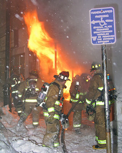 Fire begins to vent freely from the store front