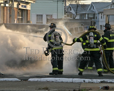 Watertown Firefighters Operating Lines On The Fire