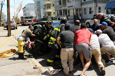 Residents jump in to help the 1st alarm companies access a blocked hydrant.