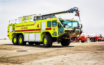 (By Brandon Barsugli) San Bernardino County Fire Station 319 located at Southern California Logistics Airport in Victorville has a 2012 Oshkosh Striker 3000 airport rescue and firefighting (ARFF) vehicle. The vehicle is one of four that County Fire uses to maintain the airport's firefighting capability as mandated by the Federal Aviation Administration. The Striker 3000 holds 3000 gallons of water, 420 gallons of Aqueous film forming foam and 450 pounds of Purple K dry chemical agent to combat fires involving flammable liquids. It has a 50 foot Snozzle with a piercing tip for penetrating the skin of an aircraft and 6 wheel drive for operation in difficult terrain. Other features include a camera on the tip of the Snozzle as well as a FLIR camera to aid in the location of heat, fire and passengers. The vehicle was purchased for $755,000 through a grant from the Federal Aviation Administration. It replaces a 1975 Oshkosh P-4, which will now be used as a reserve.