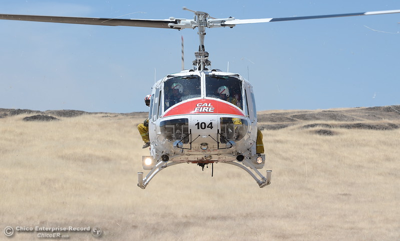 A CAL FIRE Helitack helicopter from Boggs Mt. takes off after assisting firefighters with a grass fire that burned approx. 91 acres along Nelson Road in Oroville, Calif. Tues. June 6, 2017. (Bill Husa -- Enterprise-Record)